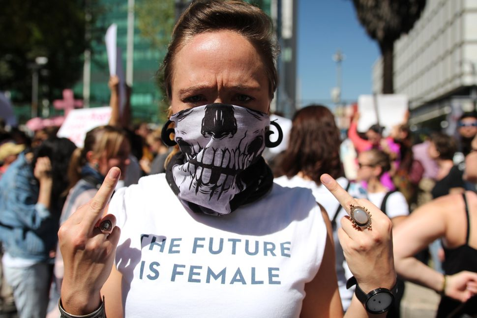 After Donald Trump's inauguration thousands of woman demonstrate in solidarity against misogyny outside U.S embassy in Mexico