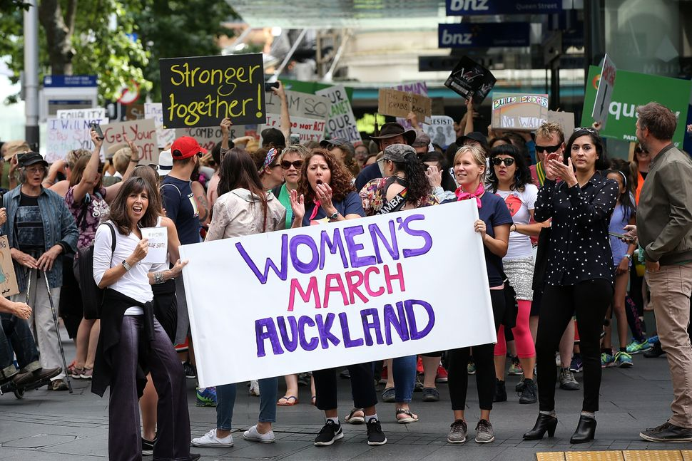 Thousands of people march up Queen Street on January 21, 2017 in Auckland, New Zealand. The marches in New Zealand were organ