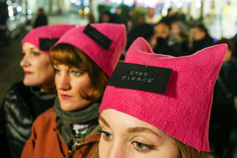 Protestors attend a women's march in front of the US Consulate General in Krakow, Poland. on January 21, 2017 in Krakow, Pola