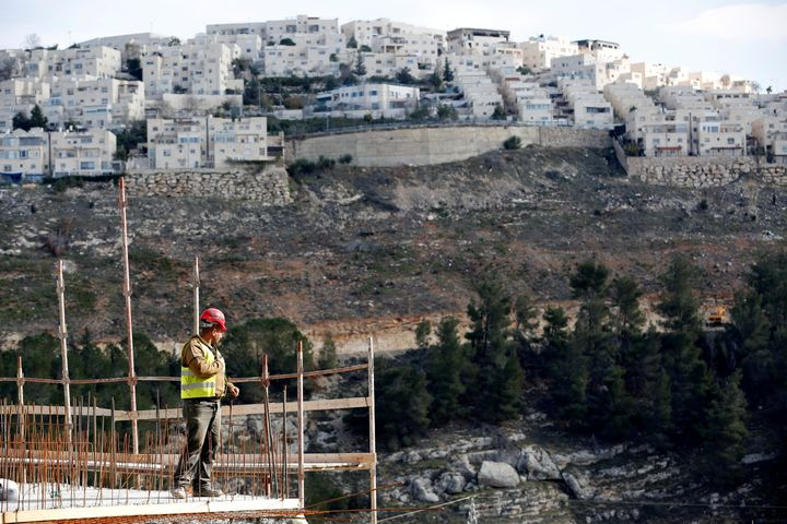 A laborer works at a construction site in the Israeli settlement of Ramot. Jerusalem's City Hall approved the buil