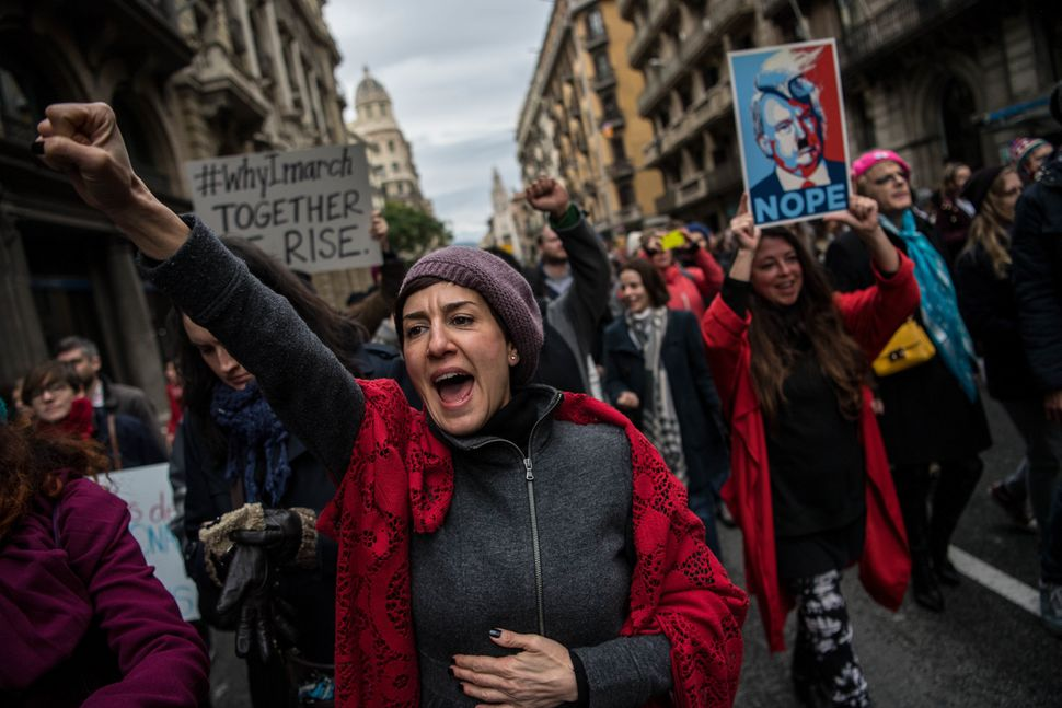 Demonstrators make their way during the Women's March on January 21, 2017 in Barcelona, Spain. The Women's March originated i