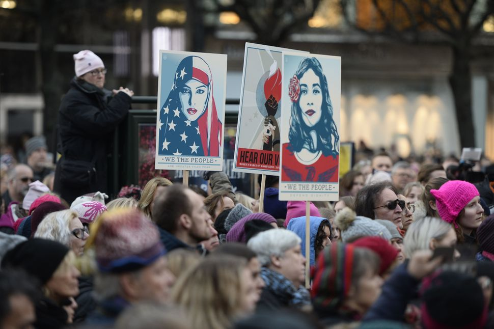 Protesters carrying placards take part in a Women's March in Stockholm, Sweden, on January 21, 2017, one day after the inaugu