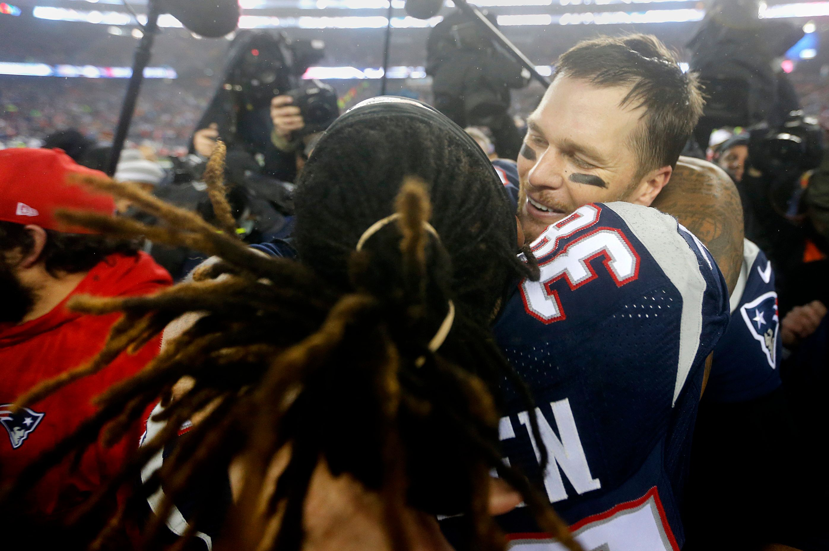 FOXBOROUGH, MA - JANUARY 22:  New England Patriots Tom Brady and Brandon Bolden celebrate after defeated the Steelers to advance to Super Bowl LI.  The New England Patriots host the Pittsburgh Steelers in the AFC Championship game at Gillette Stadium in Foxborough, Mass., on Jan. 22, 2017. (Photo by Stan Grossfeld/The Boston Globe via Getty Images)