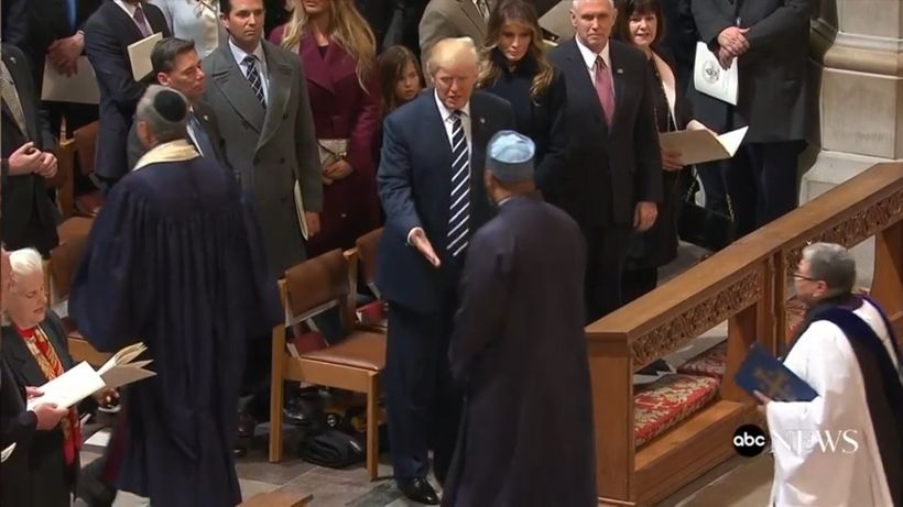 President Trump extending his hand towards Imam Magid at the National Cathedral