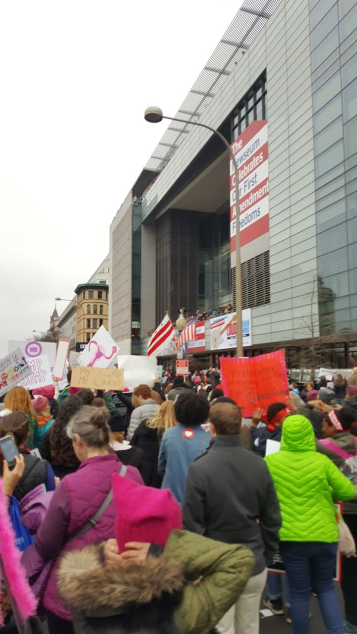 The march passes the Newseum on Pennsylvania Avenue.