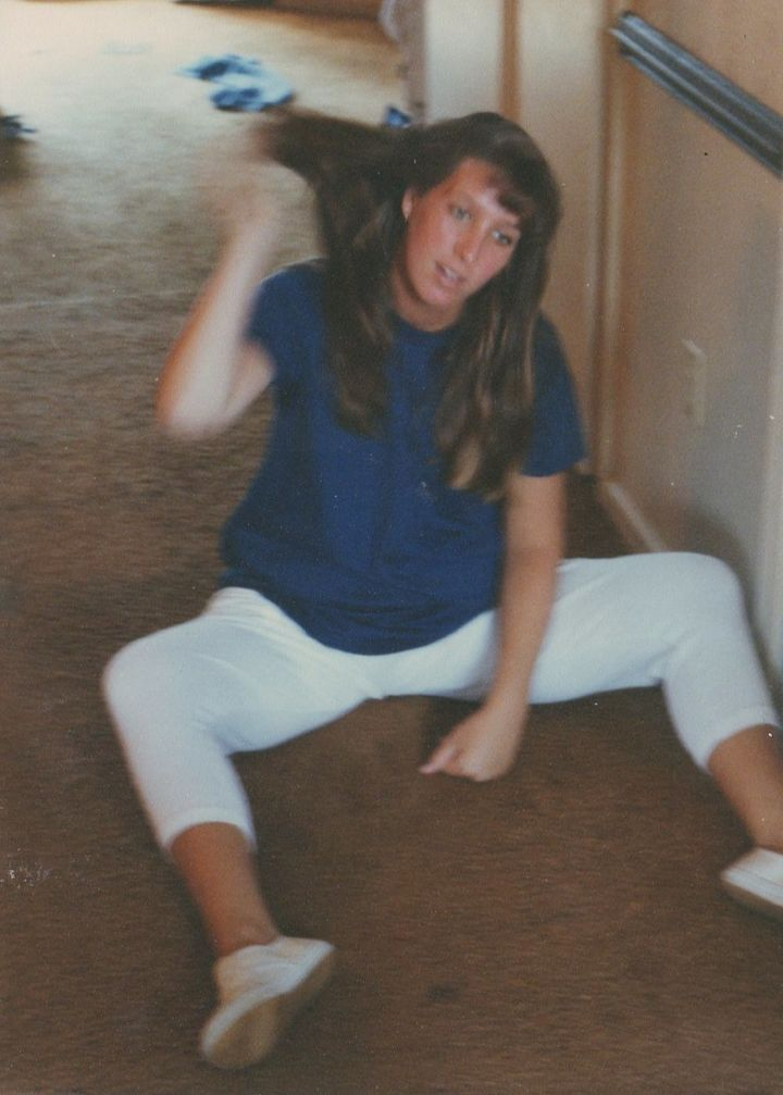 My mother, hair-flip master, pregnant with me in Norfolk, Va., 1990.