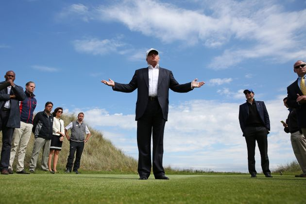 Then-Republican presidential candidate Donald Trump speaks to the media on the golf course at his Trump...