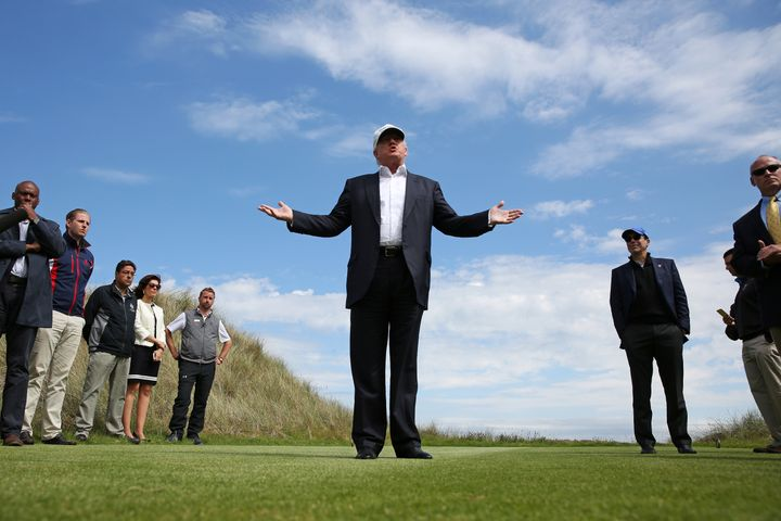 Then-Republican presidential candidate Donald Trump speaks to the media on the golf course at his Trump International Golf Li