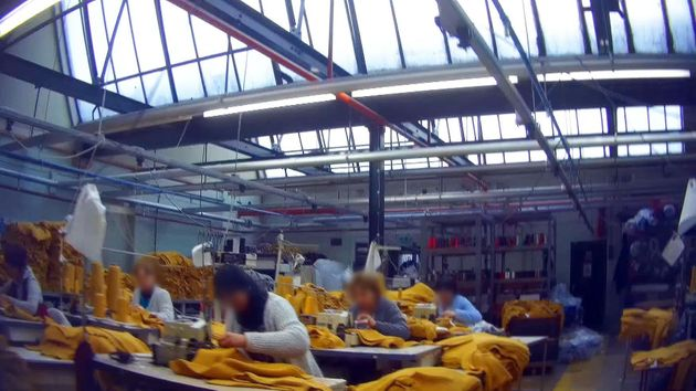 Workers making jumpers for New Look at a factory in