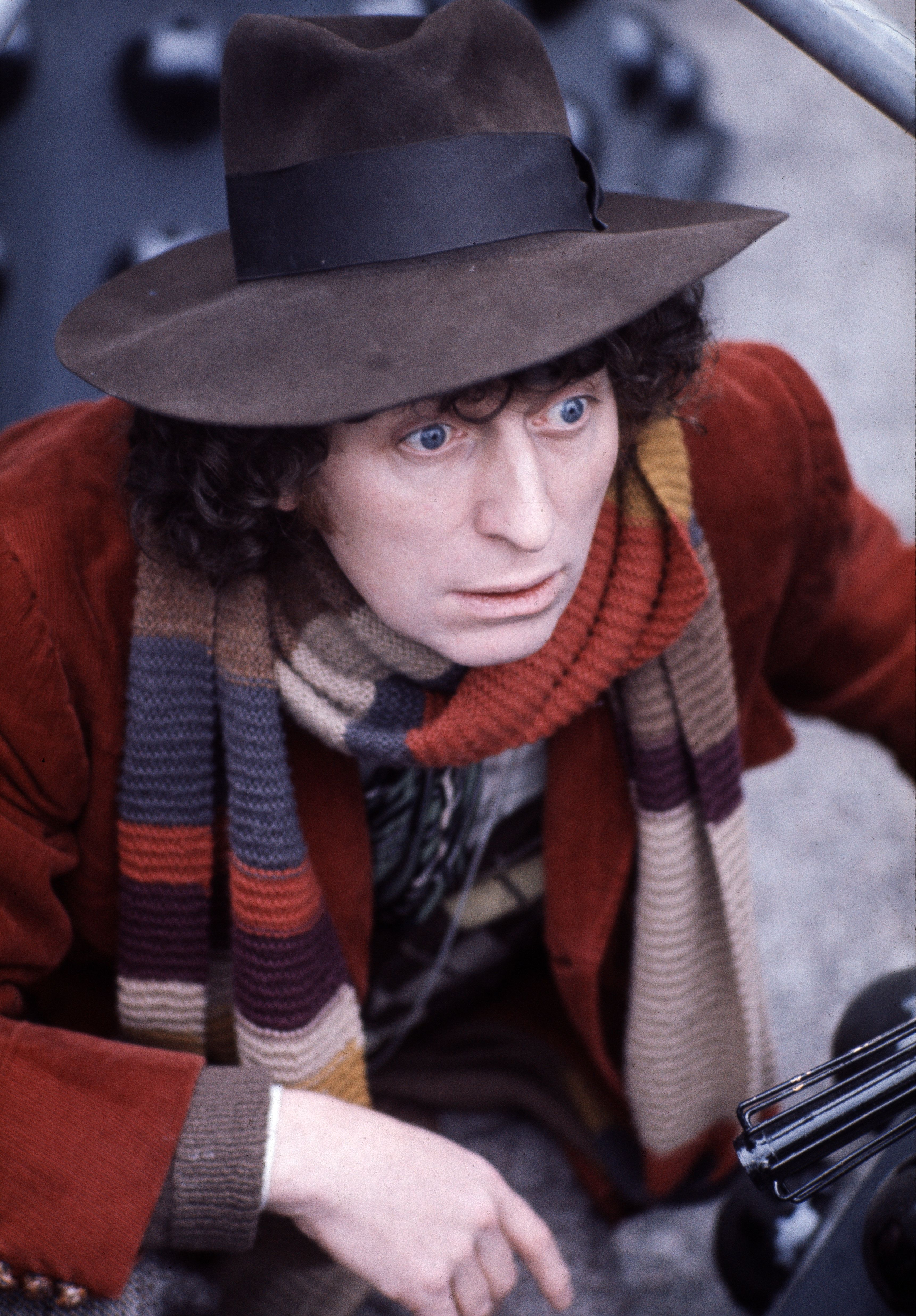 British actor Tom Baker in his best-known role as Dr Who, between two of his arch enemies, the Daleks at BBC TV Centre, London, 1974. (Photo by Michael Putland/Getty Images)