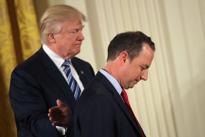 U.S. President Donald Trump congratulates White House Chief of Staff Reince Priebus during a swearing in ceremony for senior