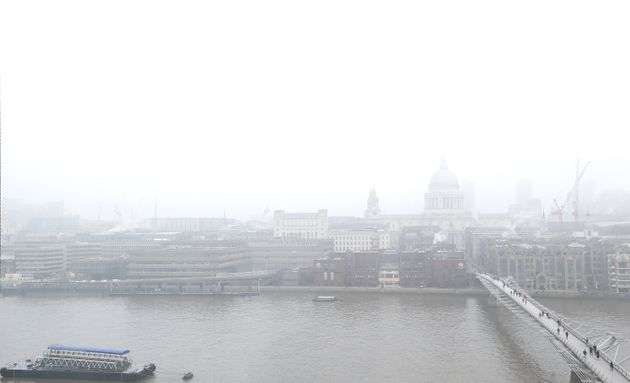 Air pollution is linked to the early deaths of around 40,000 people a year in the UK; pedestrians walk...