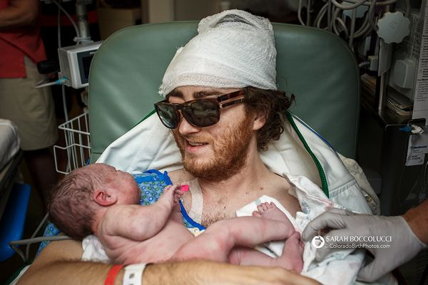 """""""Dad with brain cancer holding his baby."""""""
