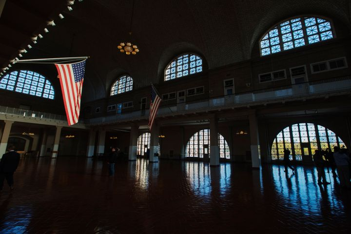 A U.S. flag hangs in the grand hall of the Ellis Island immigration museum building in New York.