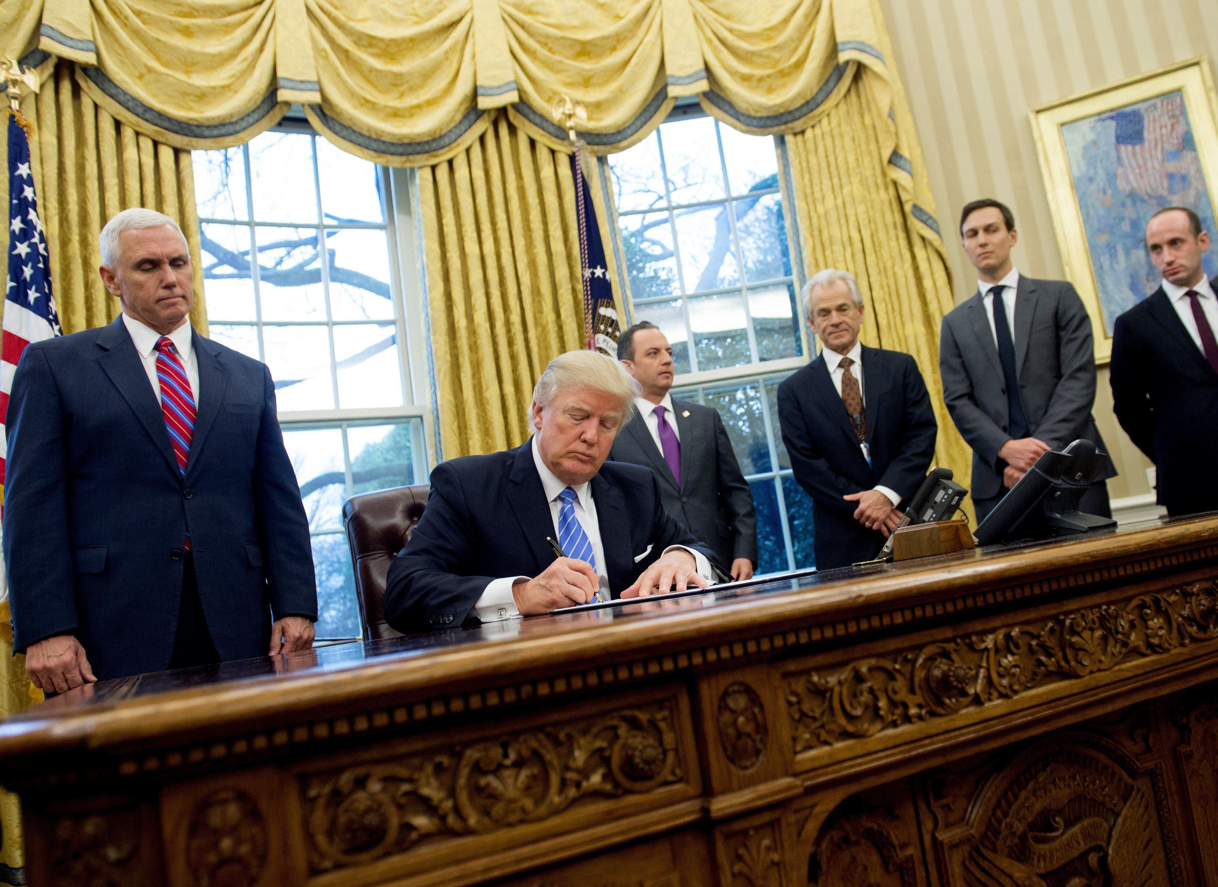 President Donald Trump signed three executive orders Monday in the Oval