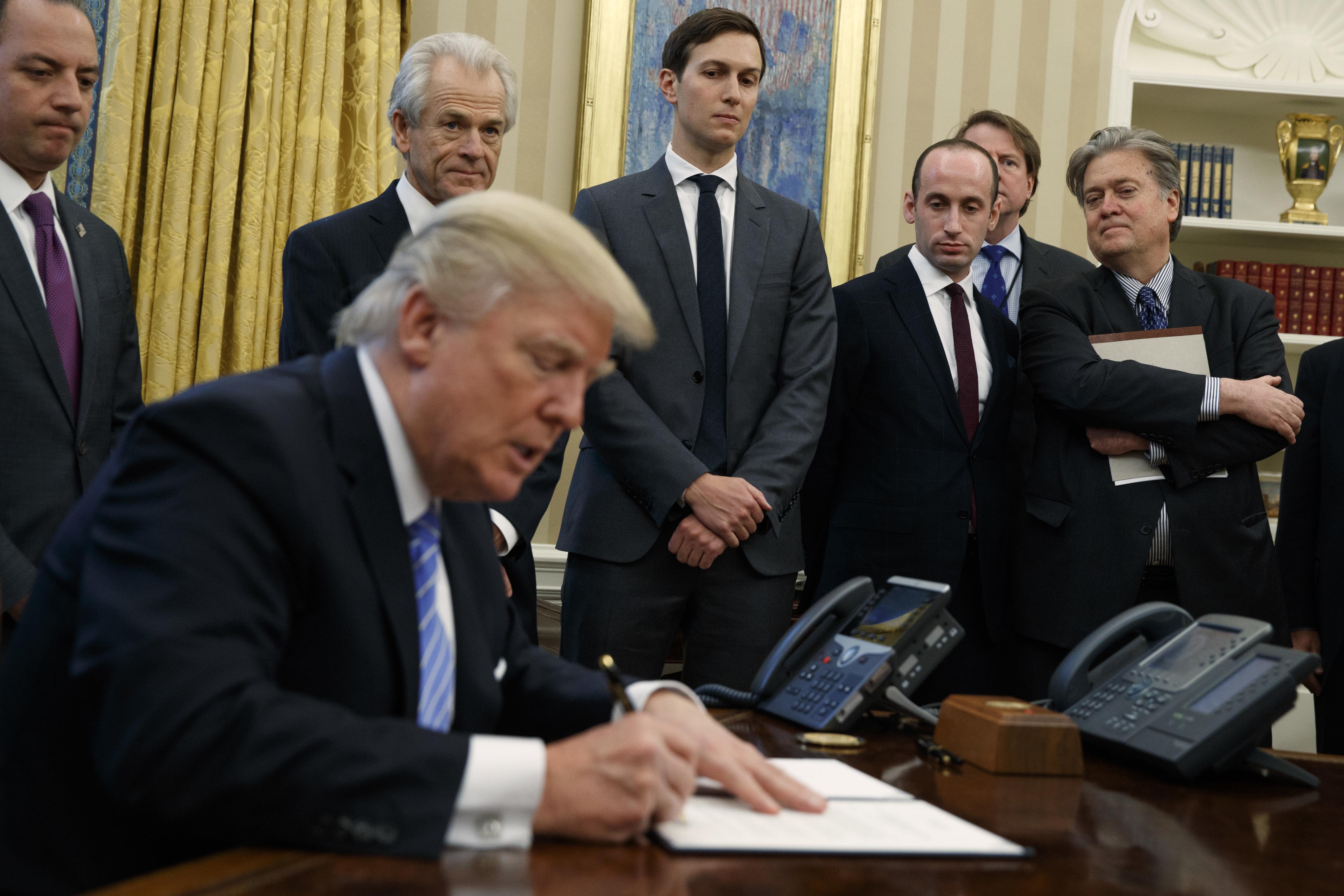 L-R:White House Chief of Staff Reince Priebus, National Trade Council adviser Peter Navarro, Senior...