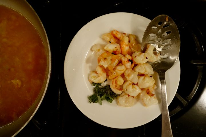 <p>Set the shrimp aside when they are <em>barely</em> cooked (the green on the plate is sage)</p>