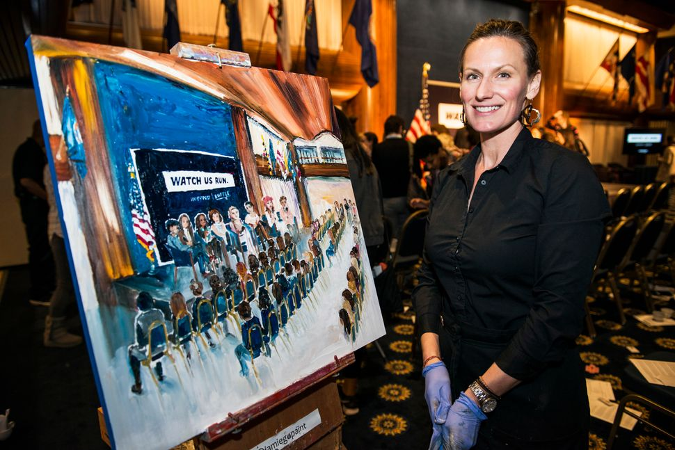 "WASHINGTON, DC - JANUARY 20: Live event painter Jamie Peterson during a Huffington Post/Bustle event called ""Watch Us Run"" at"