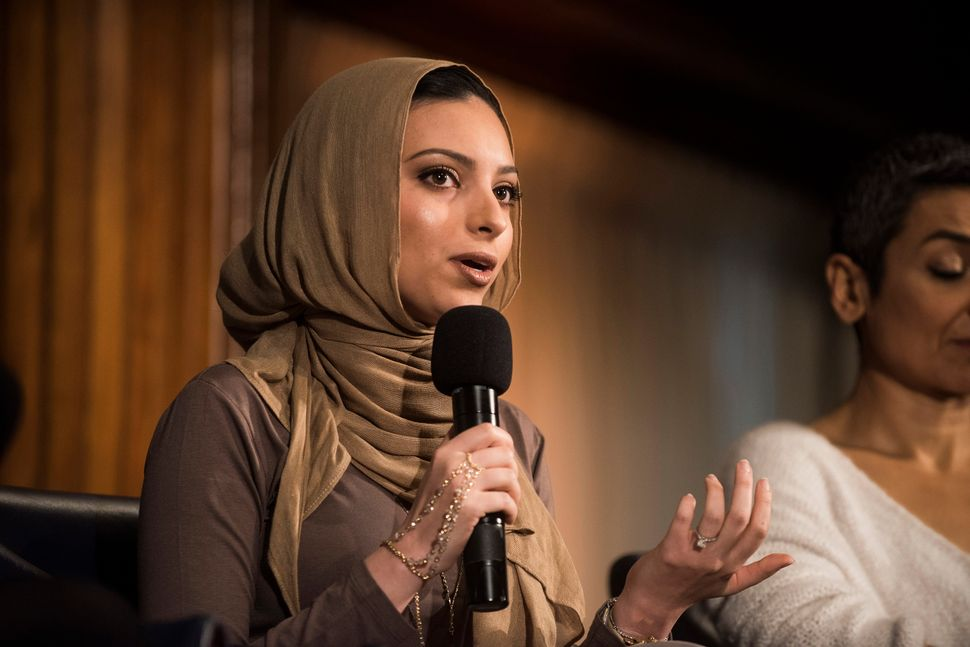"WASHINGTON, DC - JANUARY 20: Noor Tagouri speaks during a Huffington Post/Bustle event called ""Watch Us Run"" at the National"