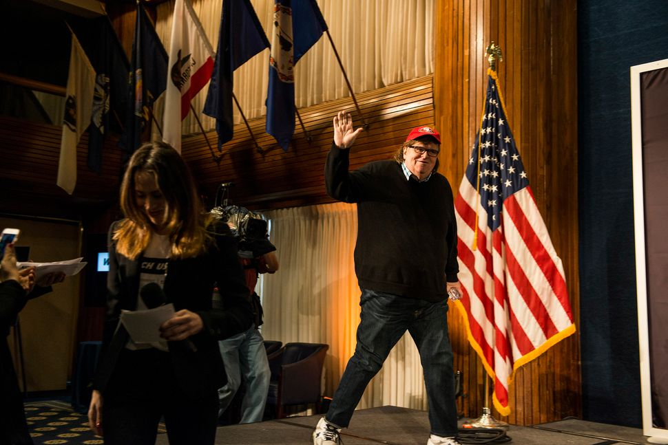 "WASHINGTON, DC - JANUARY 20: Michael Moore walks on stage at a Huffington Post/Bustle event called ""Watch Us Run"" at the Nati"