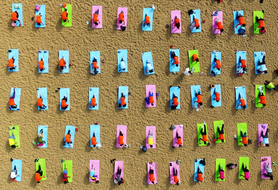 Yoga on the beach in Rizhao. Oct. 6, 2016.