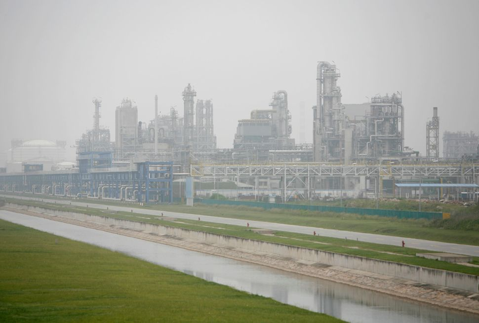 Water runs past a petrochemical plant at the Shanghai Chemical Industry Park. May 29, 2007.