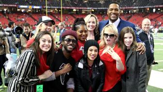 ATLANTA, GA - JANUARY 22:  TV personality Michael Strahan poses with members of the 'Pitch Perfect' cast before the NFC Championship Game between the Atlanta Falcons and the Green Bay Packers at the Georgia Dome on January 22, 2017 in Atlanta, Georgia.  (Photo by Streeter Lecka/Getty Images)