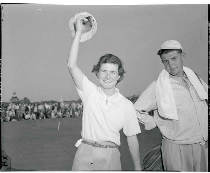 Suggs, 26, holds the Women's National Open golf championship trophy, which she won at the Prince Georges Golf Club.