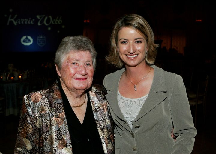Suggs, at left, poses with Karrie Webb during the LPGA celebration honoring Webb's induction into the 2005 World Golf Hall of