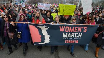 TORONTO, ON - JAN. 21: TORONTO, ON - JAN. 21: Marchers head south on Univesrity Ave. Thousands of women and girls and their families took to the streets of Toronto Saturday in a show of solidarity for women's and human rights following the inauguration of US president Donald Trump. Marchers began with a rally at Queen's Park, then marched south past the U.S. embassy, and ended with more speeches at Nathan Phillips Square.        (Jim Rankin/Toronto Star via Getty Images)