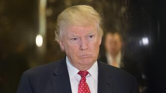 U.S. President-elect Donald Trump listens to members of the media in the lobby of Trump Tower in New York, U.S., on Monday, Jan. 8, 2017. A marathon of Senate confirmation hearings starting this week will give Democrats the chance to put Trump's Cabinet nominees on trial even though they have little chance of actually blocking any of them. Photographer: Albin Lohr-Jones/Pool via Bloomberg