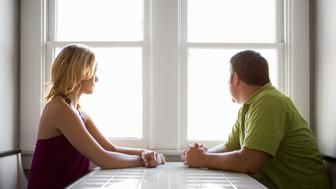 Couple staring out the window.