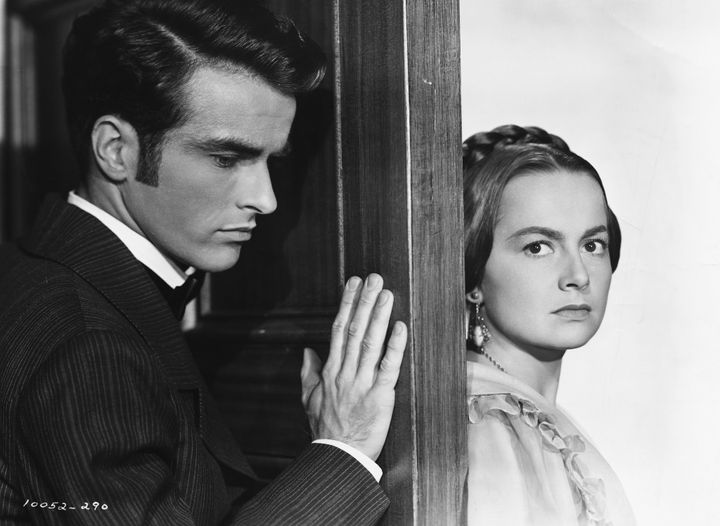 """Olivia de Havilland with Montgomery Clift in the 1949 film """"The Heiress,"""" for which she won her second Best Actress Oscar."""