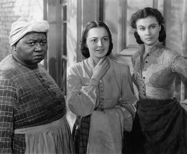 """Olivia de Havilland (center), with Hattie McDaniel and Vivien Leigh, in a scene from """"Gone with the Wind."""""""
