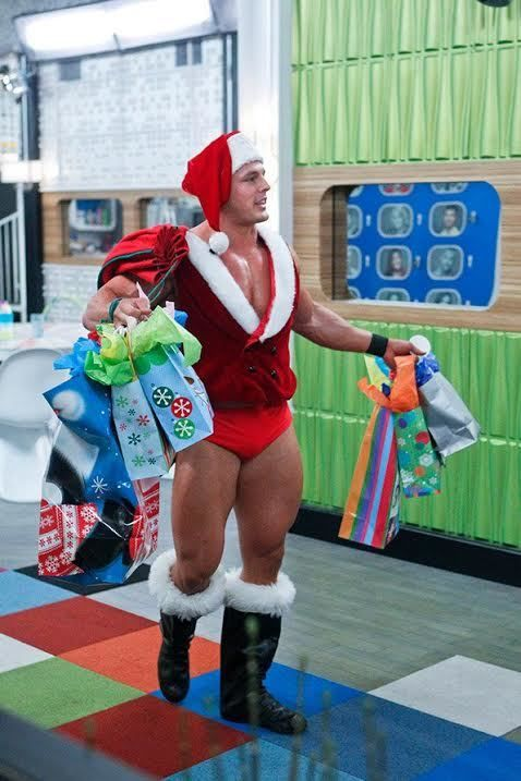 Jessie Godderz is a man of many different hats.  Here he is as Kris Kringle himself delivering bags of joy to the <em>Big Bro