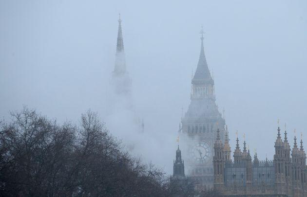 Big Ben is seen through fog and mist