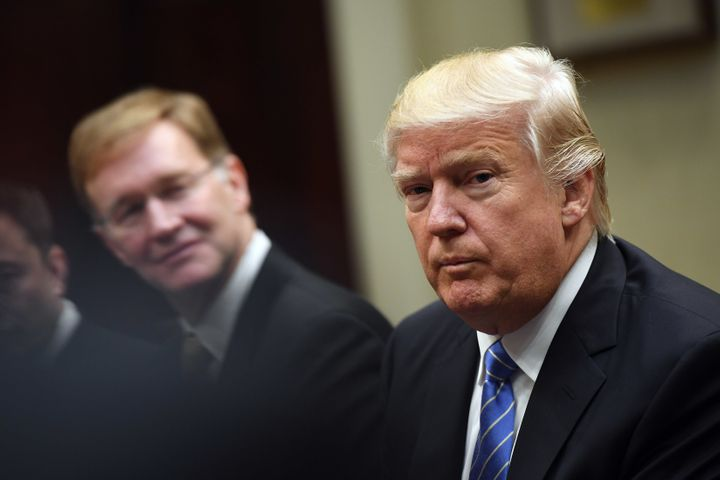WASHINGTON, DC - JANUARY 23: Wendell P. Weeks of Corning listens to President Donald Trump during a meeting with business lea