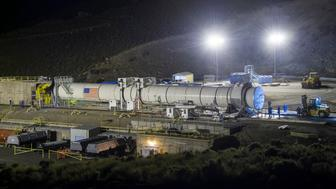 PROMONTORY, UT - JUNE 28:  In this handout provided by NASA, the Space Launch System's booster is seen a few hours ahead of the second and final qualification motor (QM-2) test, Tuesday, June 28, 2016, at Orbital ATK Propulsion Systems test facilities in Promontory, Utah. During the Space Launch System flight the boosters will provide more than 75 percent of the thrust needed to escape the gravitational pull of the Earth, the first step on NASA's Journey to Mars. (Photo by Bill Ingalls/NASA via Getty Images)