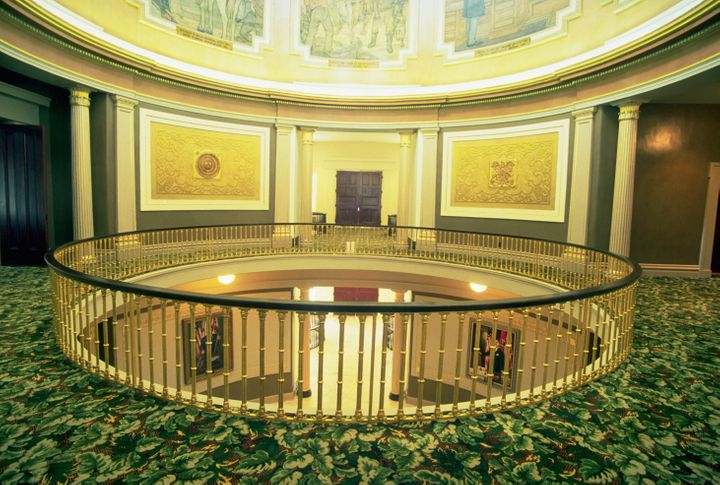The open mezzanine of the Alabama State Capitol building allows visitors to view the rotunda murals from the floor below. Mon