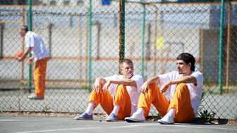 Prisoners communicating during walk