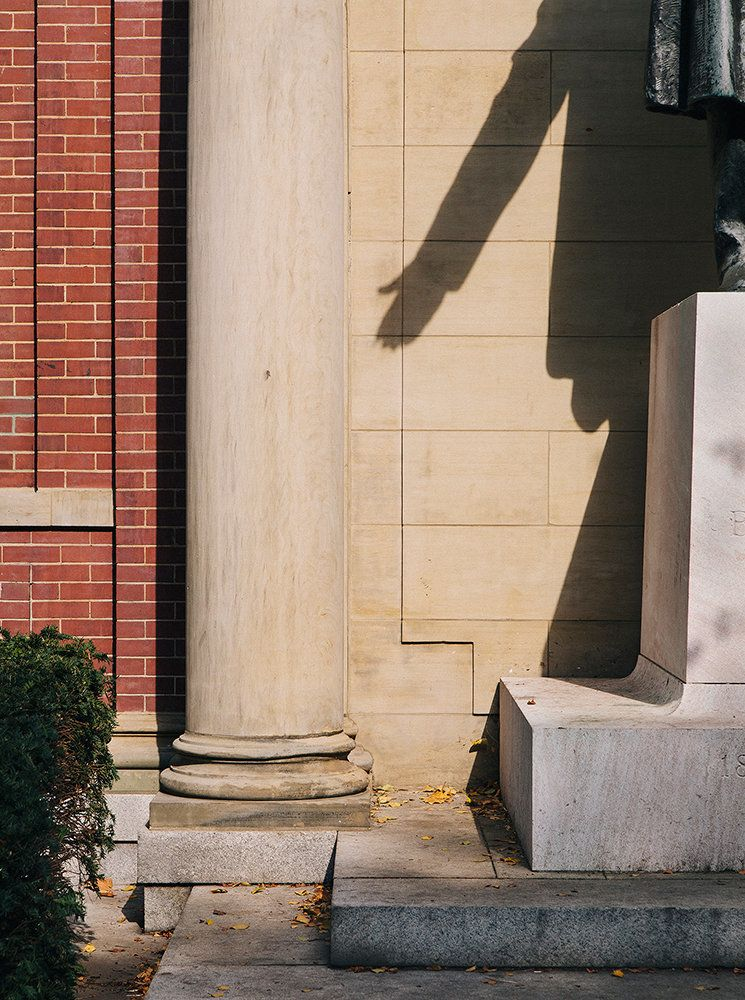 A shadow cast from a sculpture of Henry Ward Beecher. The sculpture sits near his church in Brooklyn. Beecher was an American
