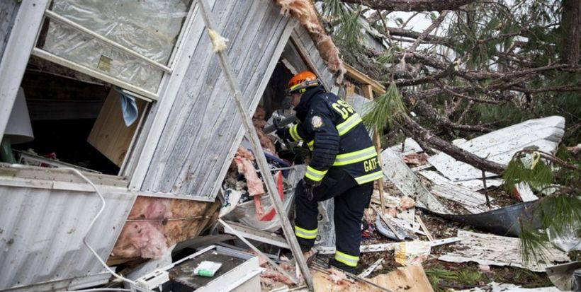 Fire and rescue crews search through devastated homes in Albany, GA looking for survivors who might have been trapped.