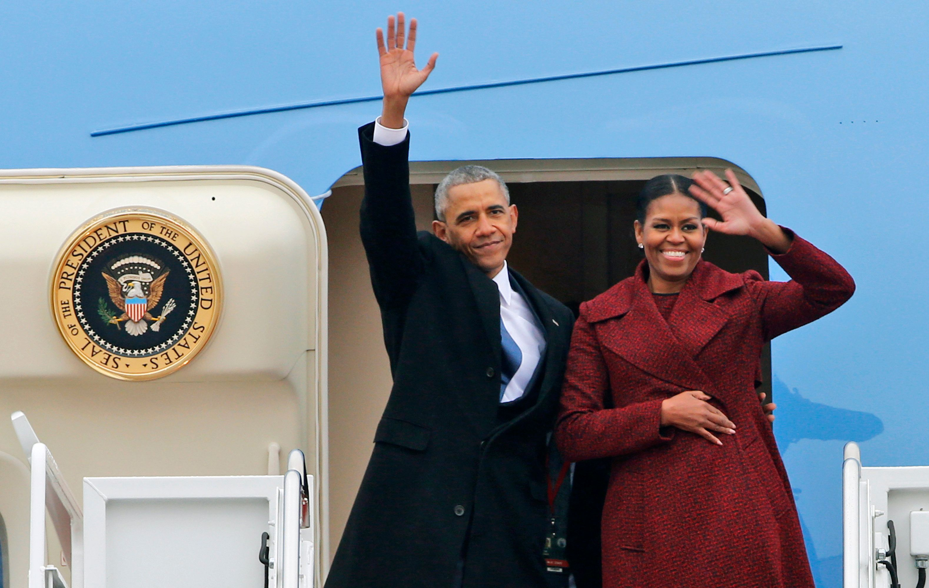 Former President Barack Obama and his wife Michelle wave to the crowd as they board an Air Force jet to depart Andrews Air Force base in Andrews Air Force Base, Md., Friday, Jan. 20, 2017. (AP Photo/Steve Helber)
