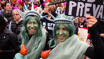 WASHINGTON, DC - JANUARY 21: Sisters, Kristina Buchwald, left of Idaho Springs, Colorado and Laura Ast, of San Francisco, CA were dressed as the statue of liberty. Thousands of people marched in Washington, DC on  Saturday January 21, 2016 for the Women's March on Washington. (Photo by Sarah L. Voisin/The Washington Post via Getty Images)