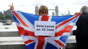 LONDON, UNITED KINGDOM - JUNE 15: A leave supporter is seen as fishing boats campaigning for Brexit sail down the Thames through central London, United Kingdom on June 15, 2016. A Brexit flotilla of fishing boats sailed up the River Thames into London today with foghorns sounding, during a protest against EU fishing quotas by the campaign for Britain to leave the European Union.  (Photo by Kate Green/Anadolu Agency/Getty Images)
