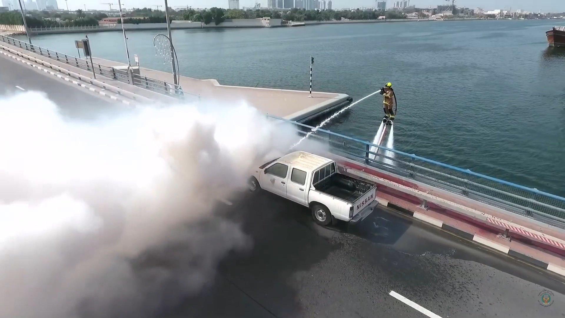 A Dubai firefighter battling a vehicle fire