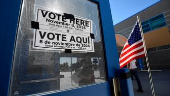 A multi-language sign directs people to a polling station during voting in the 2016 presidential election at Desert Pines High School in Las Vegas, Nevada, U.S November 8, 2016.  REUTERS/David Becker