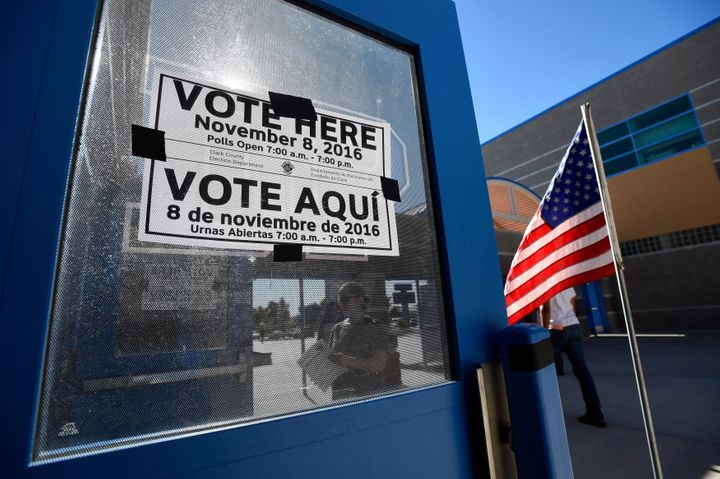 A multi-language sign directs people to a polling station during voting in the 2016 presidential election.