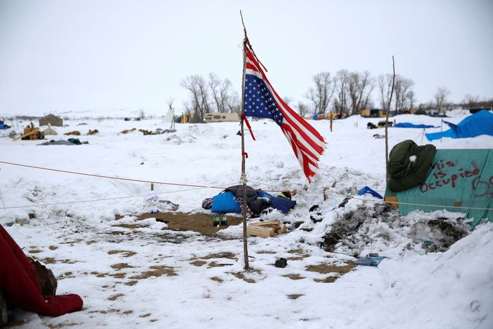 A weathered, inverted America flag catches the wind at the Dakota Access Pipeline protest camp near Cannon Ball, North Dakota