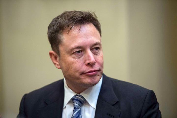 Elon Musk listens to President Donald Trump speaks during a meeting with business leaders in the Roosevelt Room at the White